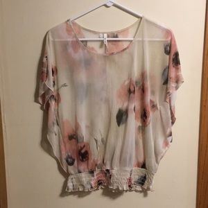 Sheer floral dolman top with ruffled elastic hem